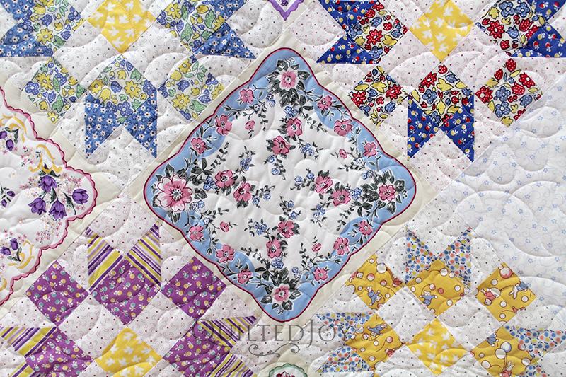 Anita made a beautiful Vintage Hankie quilt and brought it to Angela Huffman for machine quilting. She needed to find the perfect backing fabric and quilting design for it.