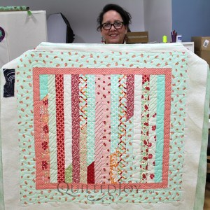 I love the colors of this sweet little quilt. Kathleen made this with our China Grove pantograph, a good choice for this piece.