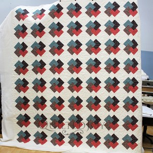 Carol brought me this lovely Card Trick quilt for quilting. Her piecing design was fairly simple, so she wanted to keep the quilting simple too. Take a look at her lovely quilt!