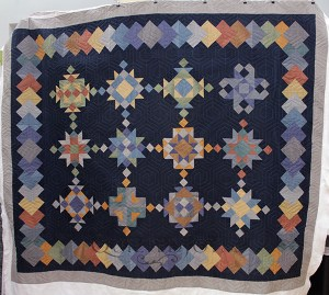 Cheri is still a new quilter, but she's making some beautiful quilts! She asked me to quilt this gorgeous sampler with a geometric edge to edge quilting design. The final results are stunning!