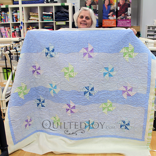 The pinwheels in Karen's quilt seem to float in the sky on her quilt!