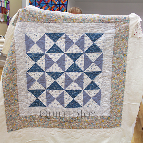 Linda quilted her Quarter Square Triangle quilt at Quilted Joy!