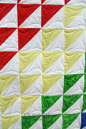 I love the rainbow effect in Pam's Half Square Triangle quilt!