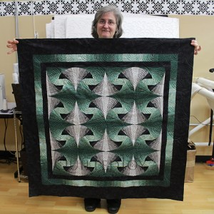Kathleen's ombre wall hanging, quilted at Quilted Joy