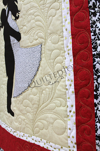 Longarm quilting nemeshing feather flourish on a signature wedding quilt