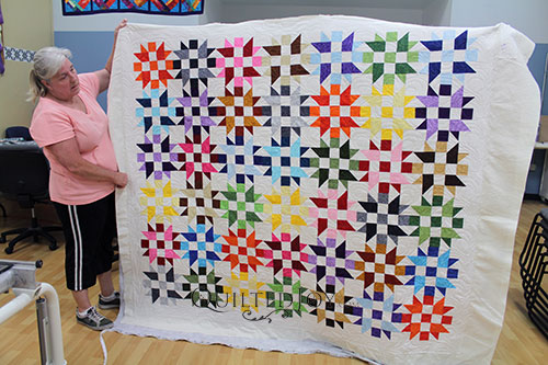 Valerie's Bright Stars Quilt after renting a longarm quilting machine at Quilted Joy
