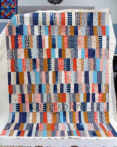House on Hill Road's Dorm Quilt after her longarm rental at Quilted Joy