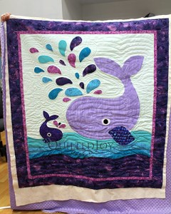 Valerie's Original Applique Whale Quilt after longarm quilting at Quilted Joy