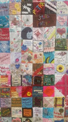A collaborative patchwork quilt to remember women killed by domestic abuse.