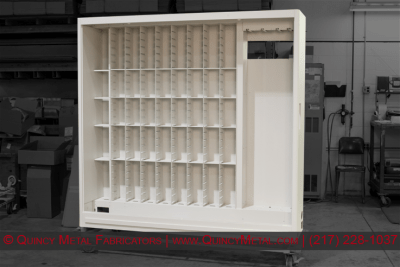 A complex precision sheet metal cabinet assembly ready for shipment
