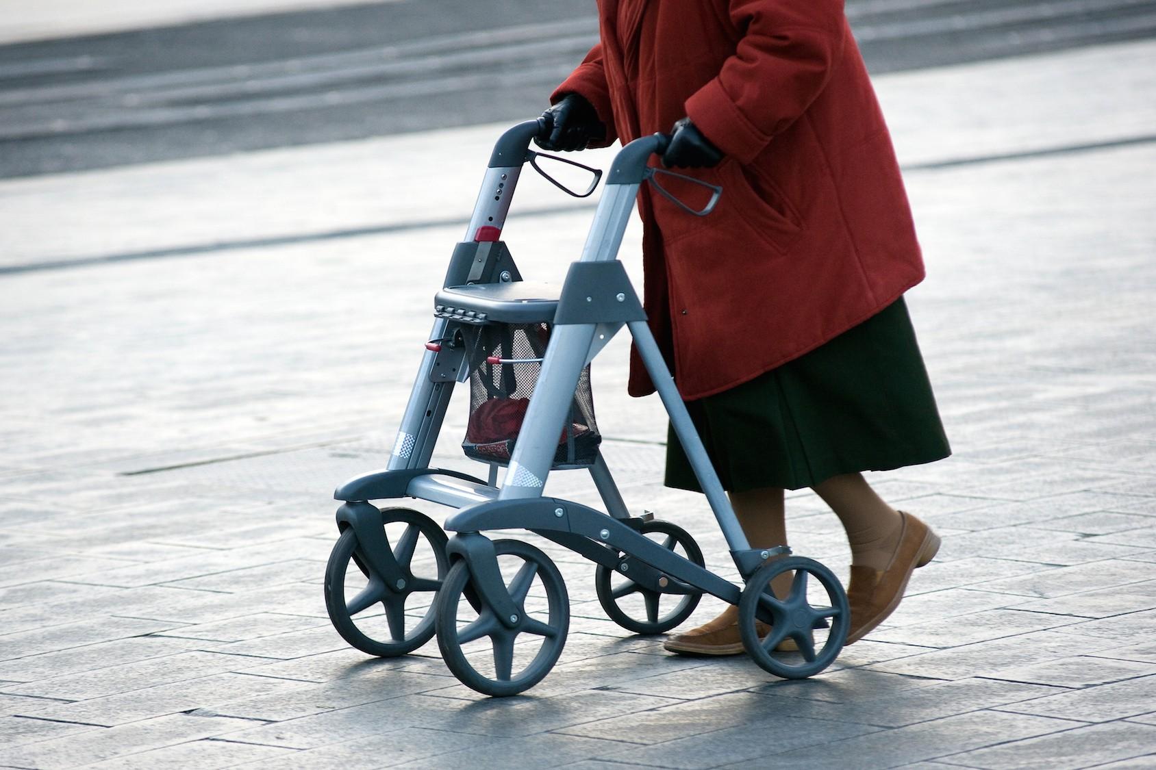 retired person using walker quinju.com