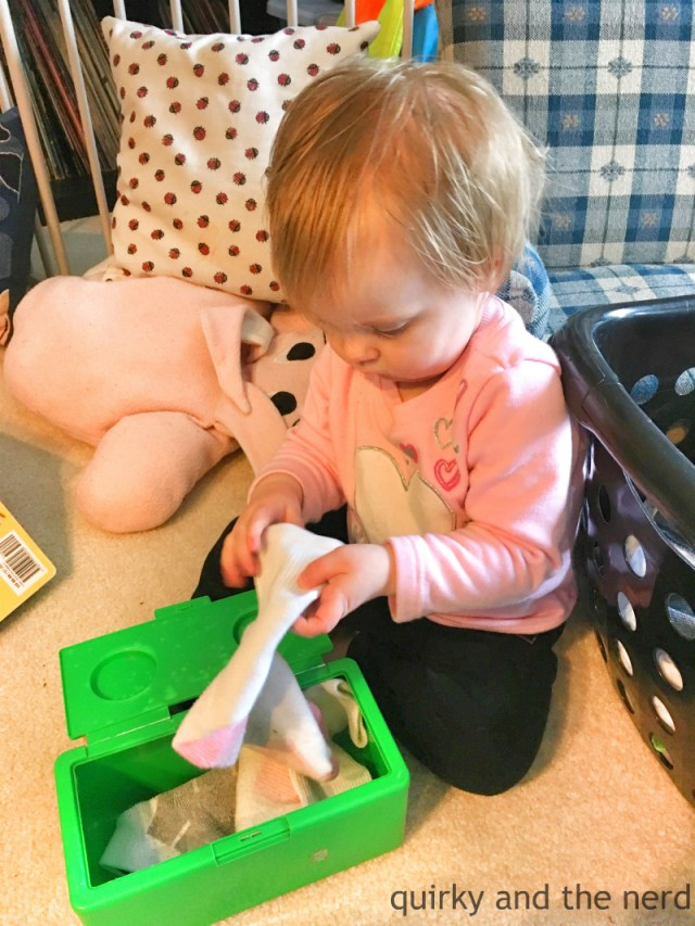 toddler helping laundry