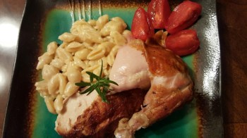 creamy homemade mac and cheese with rotisserie chicken and sliced tomatoes