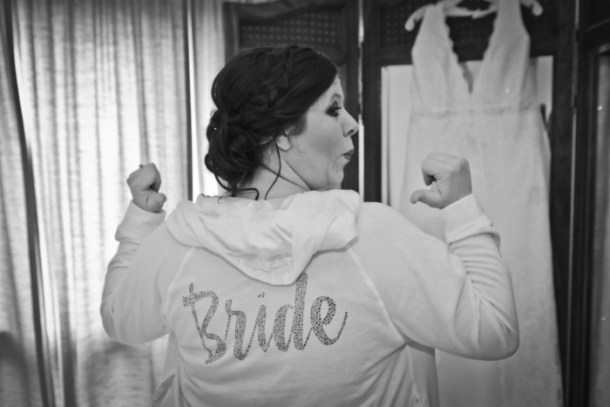 Pointing at my awesome bride hoodie in front of my tri-fold mirror where my wedding dress hung was one of my favorite photos.