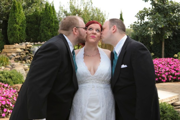 My bridesmen kissing me on the cheek at the wedding