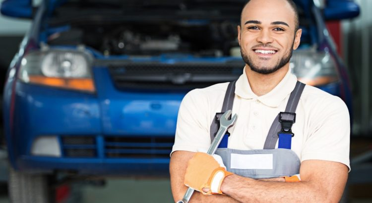 A smiling mechanic who got motor trade insurance from us