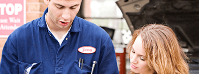 A mechanic with a female customer
