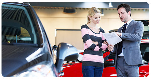 Car Dealer Insurance represented by a car dealer with a customer