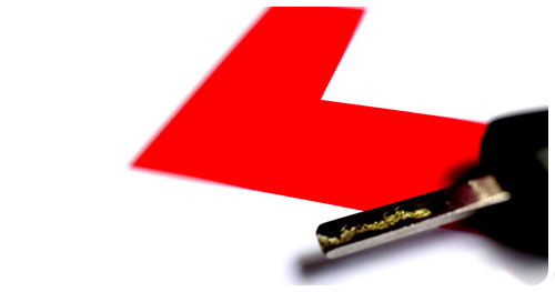 Driving Instructor Insurance represented by a Learner driver plate and a car key