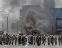 policia venezolana contra manifestantes