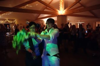 Same sex wedding couple tossing the bouquet in Redruth, Cornwall