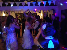 Bride & Groom Dancing in the Centre of a Circle of Friends at the Millhouse Trebarwith, Cornwall