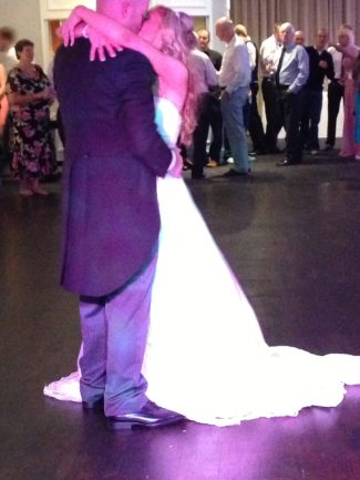 Bride & Groom Sharing a Kiss During Their First Dance in Merchants Manor, Falmouth, Cornwall