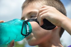 kid drinking from water bottle nalgene