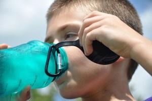kid drinking from water bottle nalgene