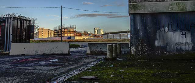 Pyrite houses uninhabitable in the shadow of Ballymun towers (© Paul Reynolds)