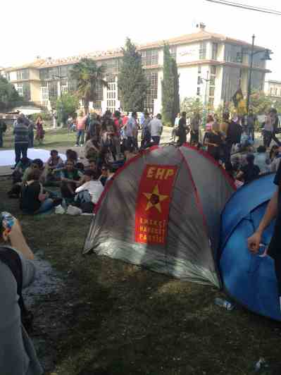 Some tents bear the logos of political parties, others slogans and drawings.