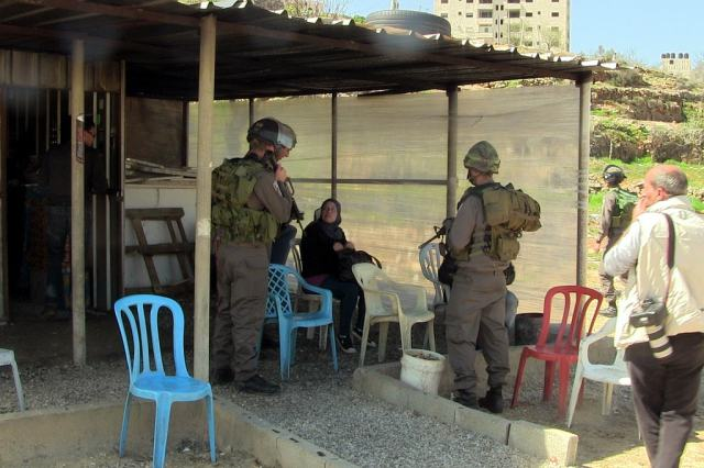 Israeli occupation forces harass Nariman Tamimi, from Nabi Saleh, as she attempts to attend her husband's, political prisoner Bassem Tamimi, hearing before a military court in Ofer Pirson. Photo From Flickr user Scott Campbell.