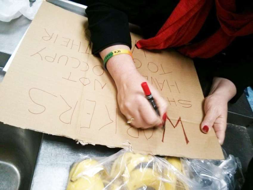 Workers prepare posters in occupation at Paris Bakery (pic: Soundmigration)