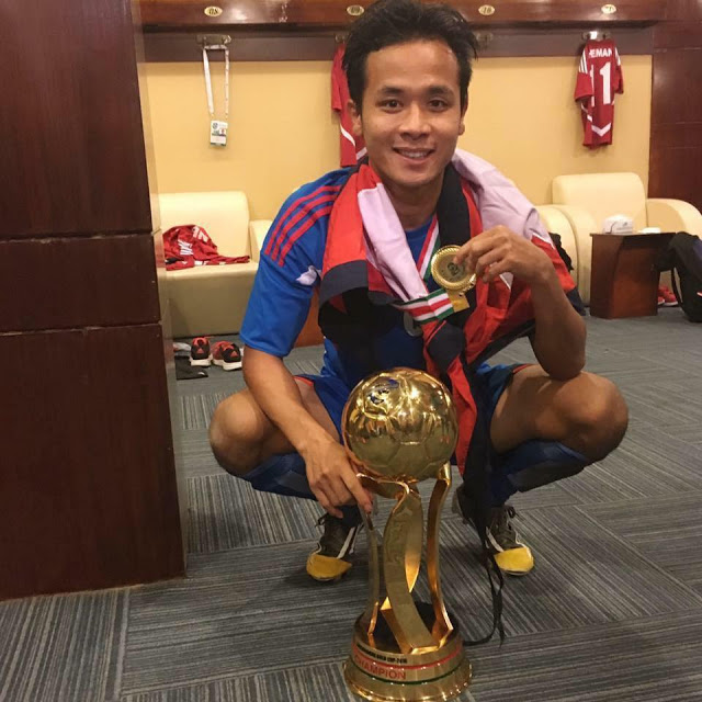 Bishal Rai with Trophy and Medal