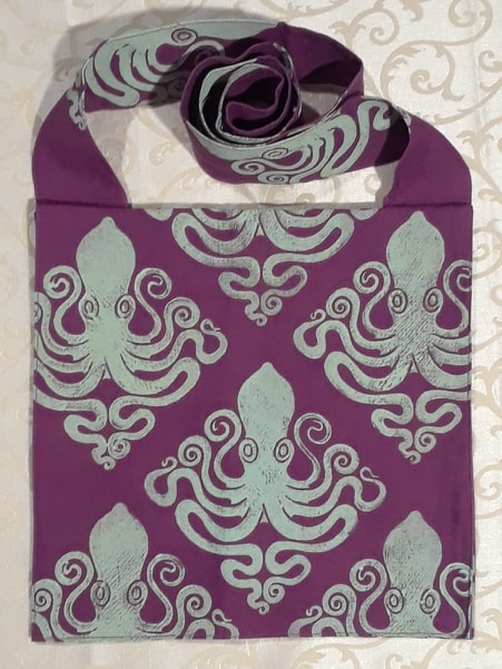 Bag made from magenta colored handprinted cotton fabric, printed with a hand carved octopus stamp.