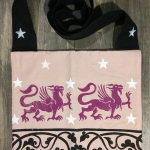 Bag made from pink and black cotton canvas, lined with black cotton fabric & hand printed with hand carved 13th century griffin & decorative border stamp as well as some stars.