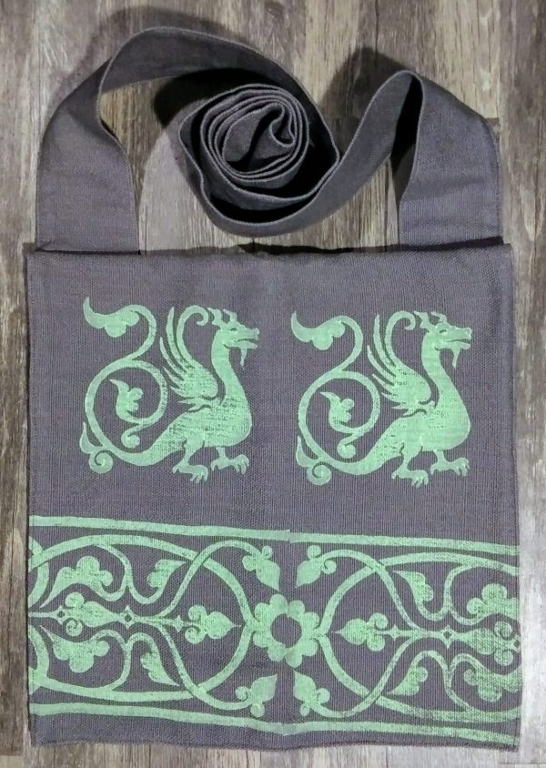 Bag made from grey cotton fabric, lined with white cotton fabric & hand printed with hand carved 13th century dragon & decorative border stamp.
