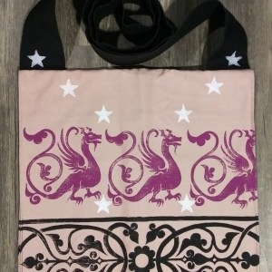 Bag made from pink and black cotton canvas, lined with black cotton fabric & hand printed with hand carved 13th century dragon & decorative border stamp as well as some stars.