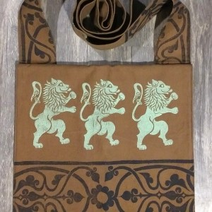 Bag made from brown cotton canvas, lined with black cotton fabric & hand printed with hand carved 16/17th century rampant lion & 13th century decorative border stamp.