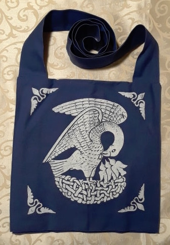 Bag made from blue cotton canvas, lined, printed with a hand carved 15th century Pelican stamp