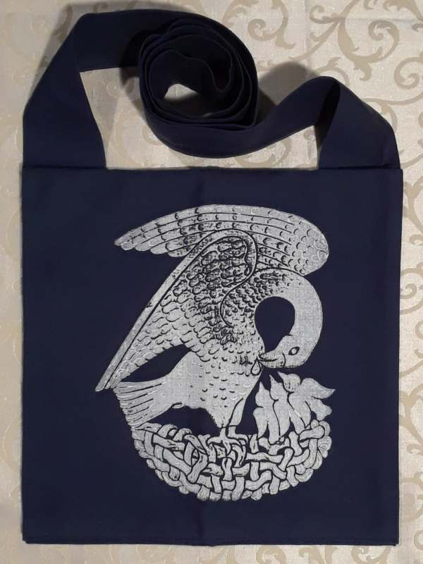 Bag made from blue cotton canvas, lined, printed with a hand carved 15th century Pelican stamp in white.