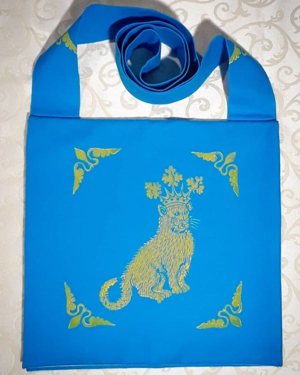 Bag made from turquoise cotton canvas, lined with yellow cotton canvas & hand printed with hand carved 15th century catking stamp.