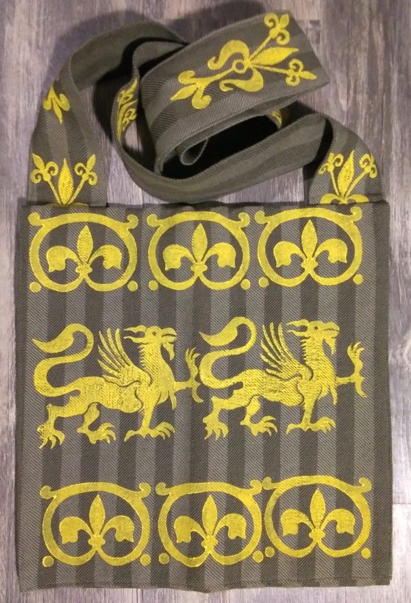 Bag made from green fabric, lined with yellow cotton fabric & hand printed in yellow with a hand carved 13th century griffin and other medieval inspired stamps.