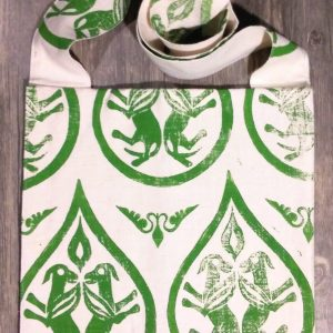 Bag made from white cotton fabric, lined with white cotton fabric & hand printed in green with a hand carved 12th - 14th century winged dog stamp.