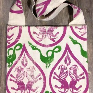 Bag made from white cotton fabric, lined and hand printed in magenta & green with hand carved 12th - 14th century winged dog and dragon stamps.