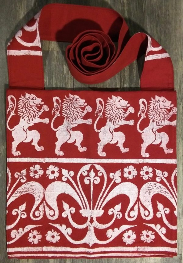 Lion bag made from red cotton canvas, lined with red cotton fabric & hand printed with hand carved 16/17th century rampant lion & 13th century decorative border stamp.