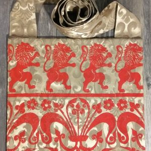 Lion bag made from golden fabric, lined with red cotton fabric & hand printed with hand carved 16/17th century rampant lion & 13th century decorative border stamp.