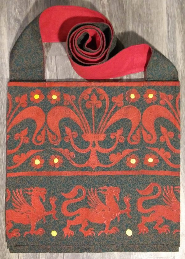 Griffin bag made from green & brown patterned fabric, lined with red cotton fabric & hand printed with a hand carved 13th century griffin & decorative border stamp.