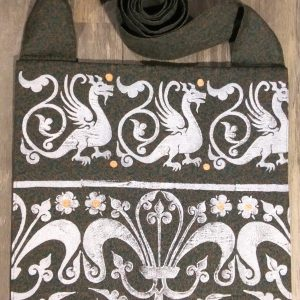 Dragon bag made from green & brown patterned fabric, lined with black cotton fabric & hand printed with a hand carved 13th century dragon & decorative border stamp.