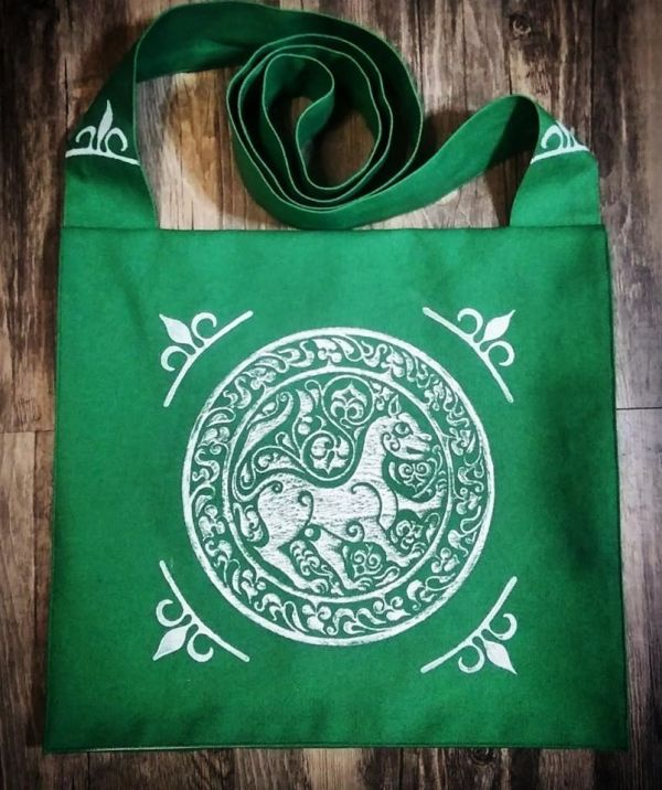 11th century Arabic lioness bag made from green cotton canvas, lined, hand printed with a hand carved 11th century middle eastern inspired lioness stamp.